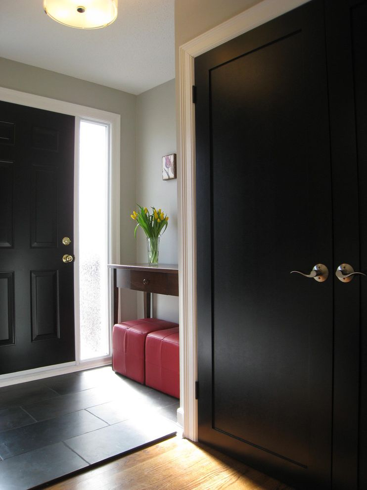 How to Change a Door Knob with Traditional Entry  and Black Door Black Front Door Black Tile Front Entrance Frosted Window Hall Ottoman Red Ottoman Red Stool Side Table Stool Tiled Floor White Trim Window Film Wood Floor
