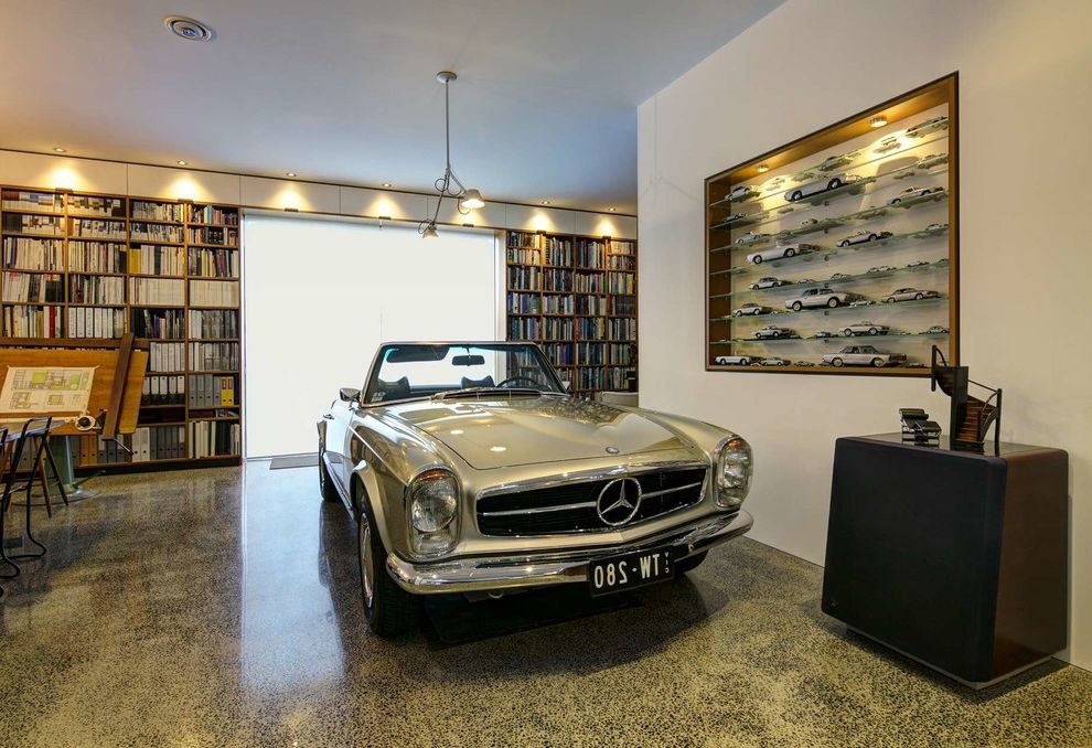 How to Clean a Garage with Contemporary Garage and Book Shelf Book Wall Built in Car in House Classic Design Collectors Room Display Room Mercedes Niche Open Concept Reading Room Recessed Lighting Timber Timeless Design