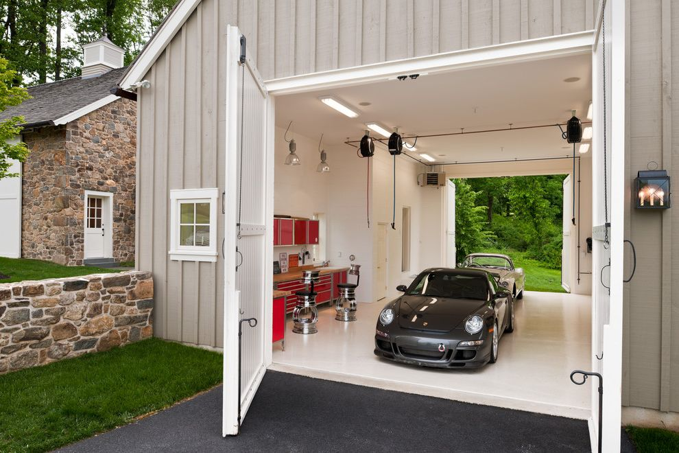 How to Clean a Garage with Farmhouse Garage and Bar Stools Board and Batten Siding Dream Garage Drive Thru Garage Garage Organization Large Carriage Doors Red Cabinets Stone Wall Tool Cabinets Tool Storage White Garage Doors White Garage Floor