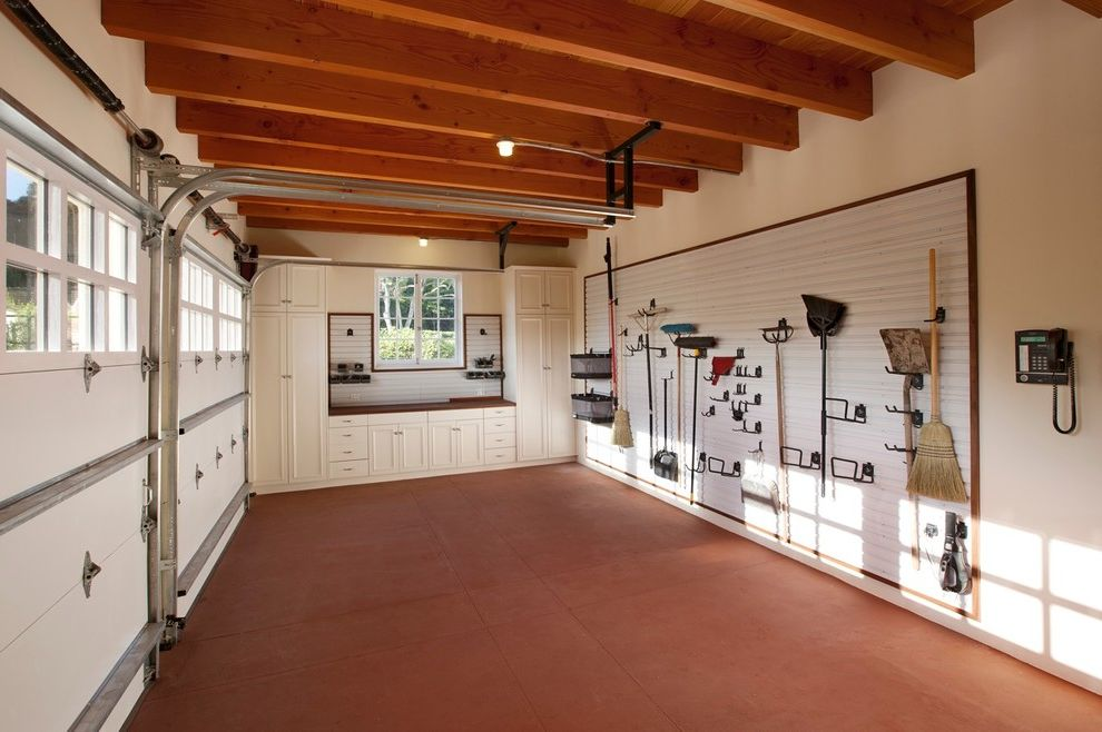How to Clean a Garage with Traditional Garage and Bench Built in Cabinets Ceiling Light Cement Floor Earth Tones Garage Door Garage Storage Tool Rack White Wall Window Wood Beams