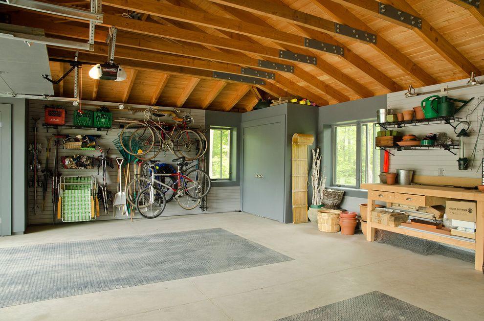 How to Clean a Garage with Traditional Garage and Bike Storage Fir Rafters Floor Mats Garage Potting Bench Rollup Garage Door Wall Racks Wood Ceiling