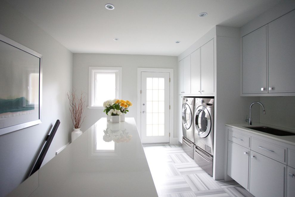 How to Clean Front Load Washer with Modern Laundry Room Also Built in Storage Carpet Flooring Carpet Tiles Ceiling Lighting Floral Arrangement Front Load Washer Dryer Neutral Colors Recessed Lighting Wall Decor White Wood Wood Trim