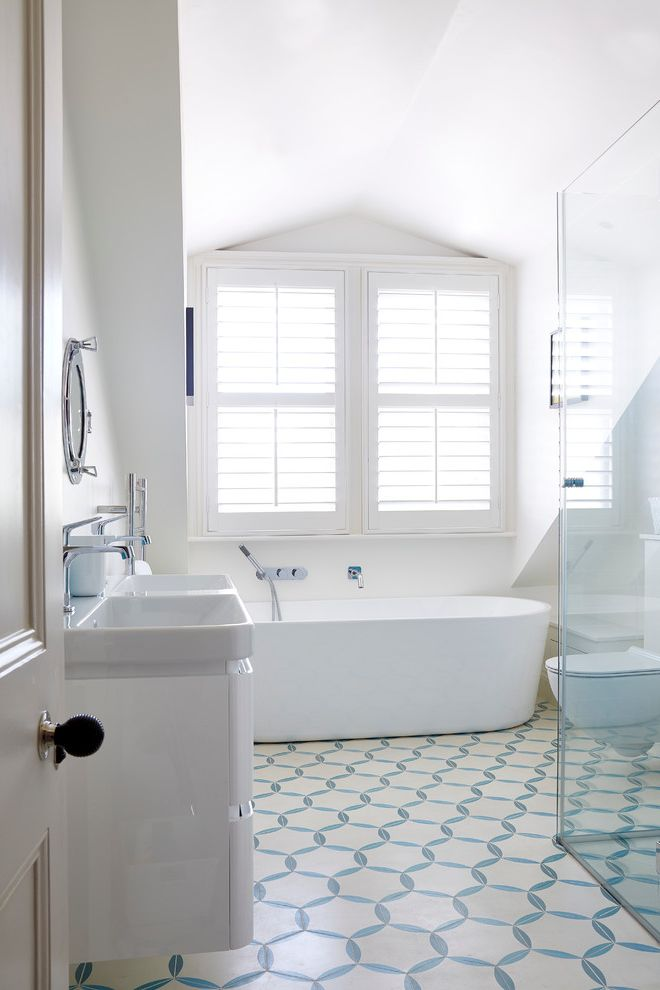 How to Clean Grout on Tile Floors   Transitional Bathroom  and Bathroom Floor Tile Bathroom Shutters Bathroom Tile Blue Blue and White Floor Tile Freestanding Bath Plantation Shutters Pop of Color Subtle Vaulted Ceiling White Bathroom