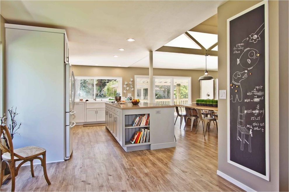 How to Clean Luxury Vinyl Tile with Contemporary Kitchen Also Caesarstone Countertops Ceiling Lights Chalkboard Exposed Beams Kitchen Countertops Kitchen Island Neutral Colors Pendant Lighting Plank Flooring