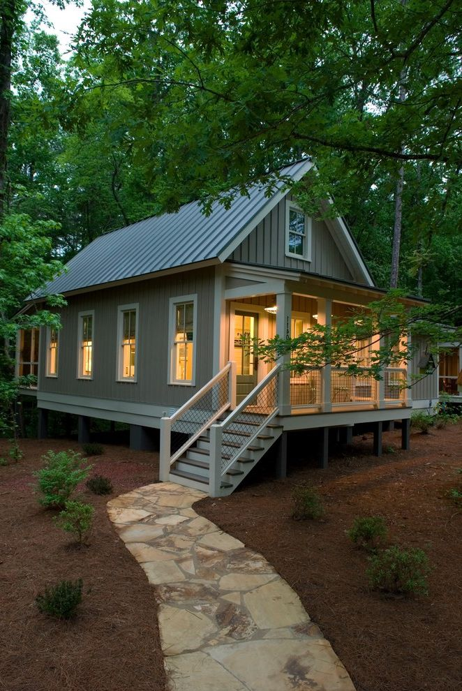 How to Find Square Footage with Rustic Exterior Also Board and Batten Siding Cabin Covered Porch Craftsman Gable Roof Gray Siding Lean to Roof Metal Roof Mulch Paved Pathway Porch Steps Refined Rustic Stone Path Vertical Seam White Railing