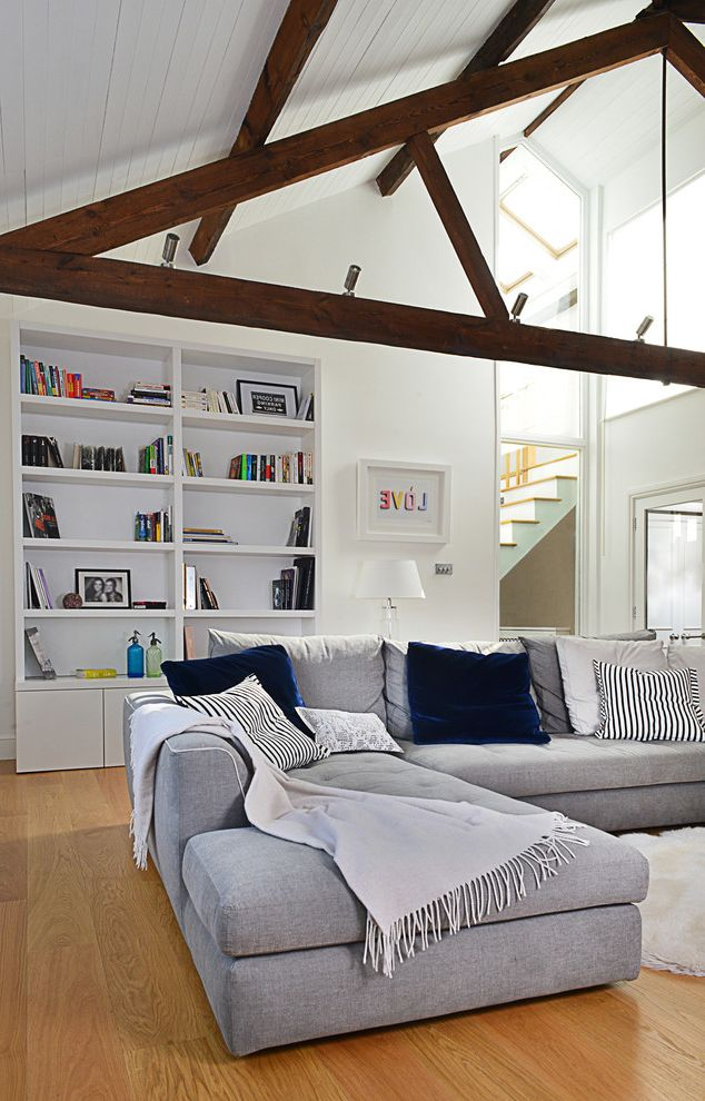 How to Get Rid of the Smell of Cigarette Smoke   Contemporary Living Room Also Beams Blue Velvet Cushion Bookcase Exposed Beams Exposed Rafters Grey Corner Sofa Grey Sofa Neutral White Grey Indigo Skylights