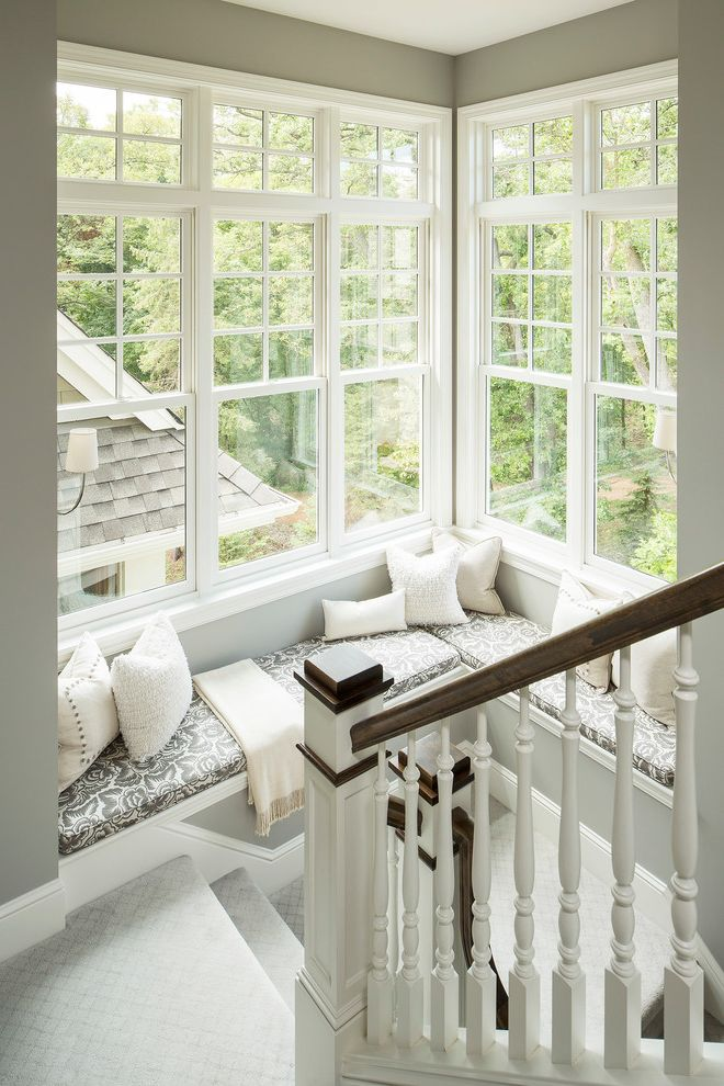 How to Get Streak Free Windows with Traditional Staircase  and Balusters Baseboard Built in Bench Carpet Corner Windows Cushions Khaki Wall Landing Muntins Neutral Colors Seat Cushions Stair Runner Throw White Banister Window Seat Wood Handrail