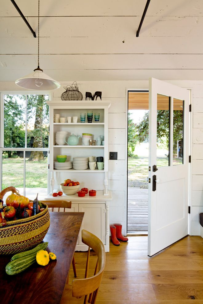How to Grow Okra with Farmhouse Kitchen  and Charming China Cabinet Eat in Kitchen Glass Pane Door Kitchen Market Basket Painted Wood Pendant Light Push Button Switch Tiny House Vaulted Ceiling White Painted Wood Wire Basket Wood Planks Wood Table