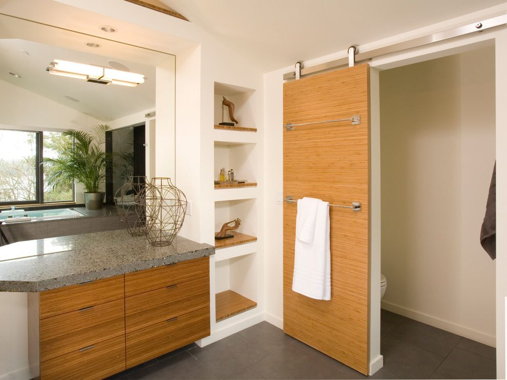 How to Hang Cabinet Doors with Contemporary Bathroom and Bamboo Built in Shelves Flat Panel Cabinets Large Mirror Open Shelving Separate Toilet Room Sliding Barn Door Tile Floor Wall Sconce White Walls Wire Vase