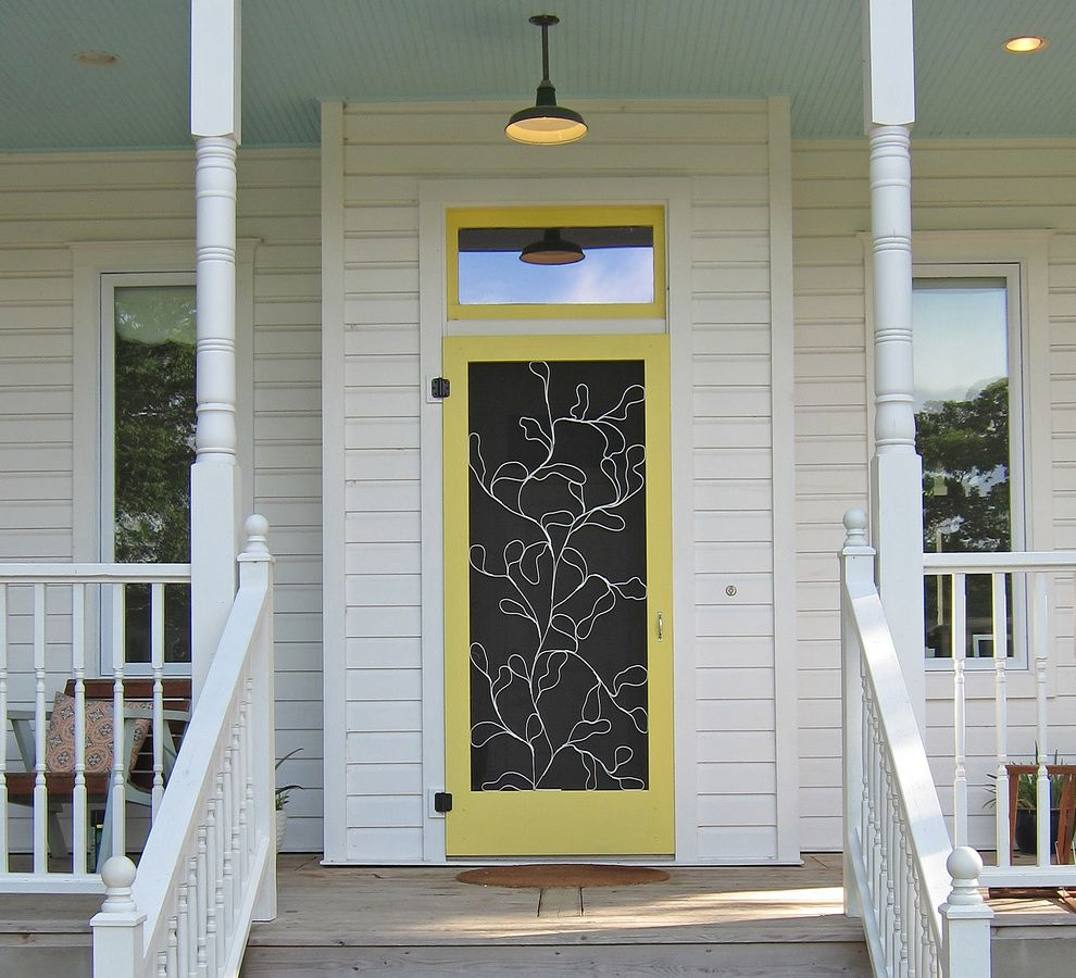 How to Install a Screen Door   Traditional Entry Also Barn Pendant Covered Porch Entry Front Door Front Porch Grillwork Outdoor Lighting Painted Ceiling Screen Door Screen Door Insert Spindle Railing Transom Wood Ceiling Wood Siding Yellow Front Door