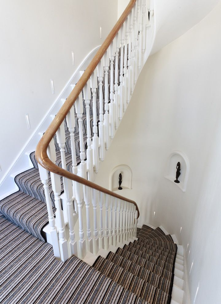 How to Install Carpet on Stairs   Traditional Staircase  and Architects London Carved Balusters Curved Staircase Curved Walls Home Architects Interior Design Recessed Shelves Stained Handrail Stair Lighting Stair Runner Striped Runner White Walls