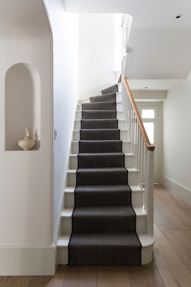 How to Install Carpet on Stairs with Victorian Staircase Also Black and White Entry Niche Stair Runner Staircase Staircase Carpet Striped Carpet Stairs Striped Stair Runner White Banister White Painted Stairs Wood Handrail