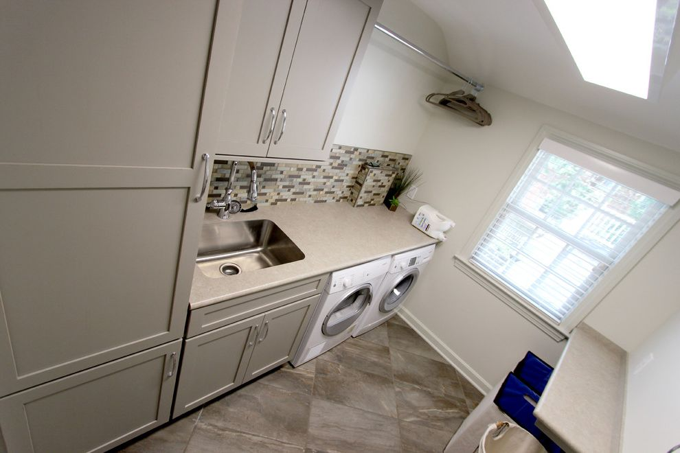 How to Install Formica with Transitional Laundry Room  and Concrete Stone Countertop Essence Tile Formica Laminate Grey Laundry Room Harbor Mist Painted Finish Medallion Moen Faucet Potter Mill Door