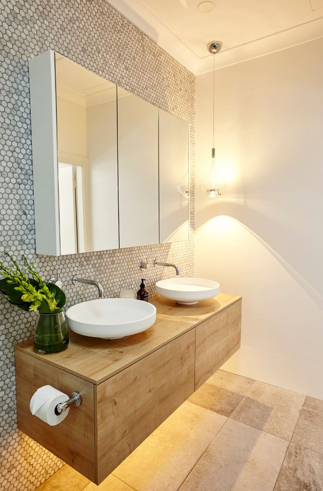 How to Light a Bowl   Contemporary Bathroom Also Carrara Marble Custom Cabinetry Double Vanity Floating Vanity Glass Pendant Light Mirrored Medicine Cabinet Wall Mounted Faucet