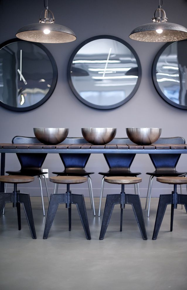 How to Light a Bowl   Modern Dining Room  and Barn Lights Black Chairs Bowls Concrete Floor Dining Stools Gray Walls Round Mirrors Work Space