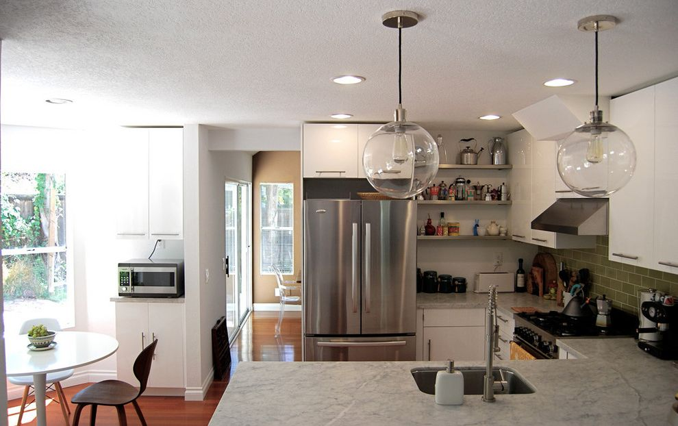 How to Light a Bowl   Modern Kitchen  and Backsplash Carrera Marble Counter Coffee Eat in Kitchen Globe Pendant Lights Green Tile Heath Ceramics Kettle Collection Stainless Steel Appliances Tulip Table