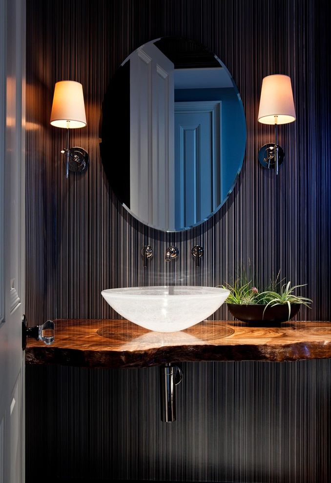 How to Light a Bowl   Tropical Powder Room  and Lacquered Wood Countertop Laquered Wood Countertop Oval Mirror Sconces