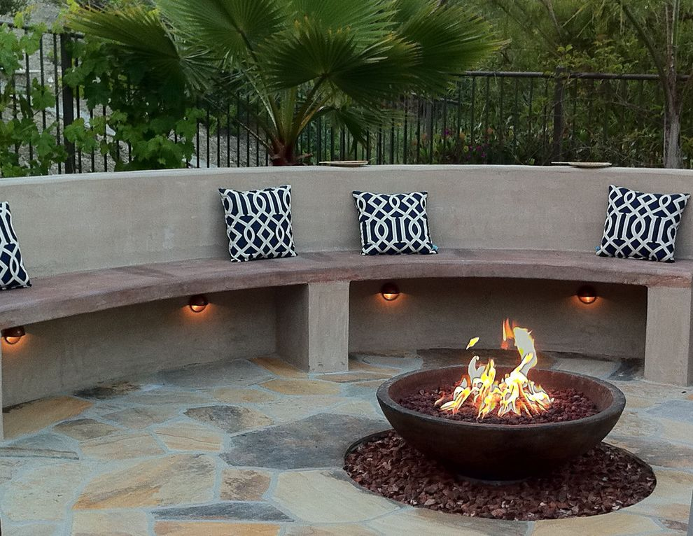 How to Light a Bowl with Mediterranean Patio  and Backyard Concrete Bench Fire Fire Bowl Fire Pit Firepit Hardscape Design Landscape Landscape Lighting Orange County Outdoor Lighting Palm Trees Patio Pavers Planting San Clemente