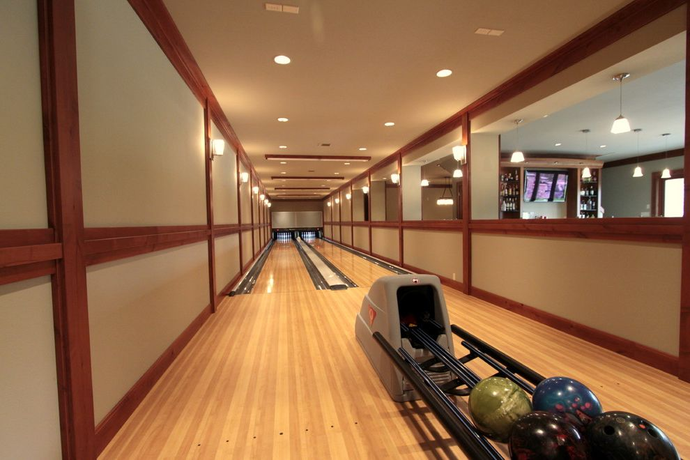 How to Light a Bowl with Traditional Basement  and Bowling Alley Dark Stained Wood High Polished Floors Lanes Natural Wood Floors Recessed Lights Sports Windows Wood Trim