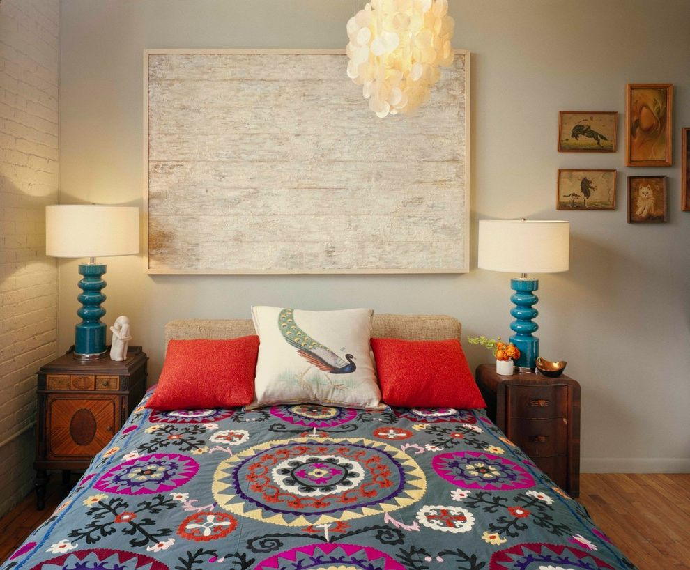How to Make Your Bedroom Cozy   Eclectic Bedroom Also Antique Nightstands Blue Bedside Lamps Blue Lamps Blue Table Lamps Drum Shades Eclectic Bedding Painted Brick Wall Patterned Bedding Peacock Pillow Red Pillows Upholstered Headboard