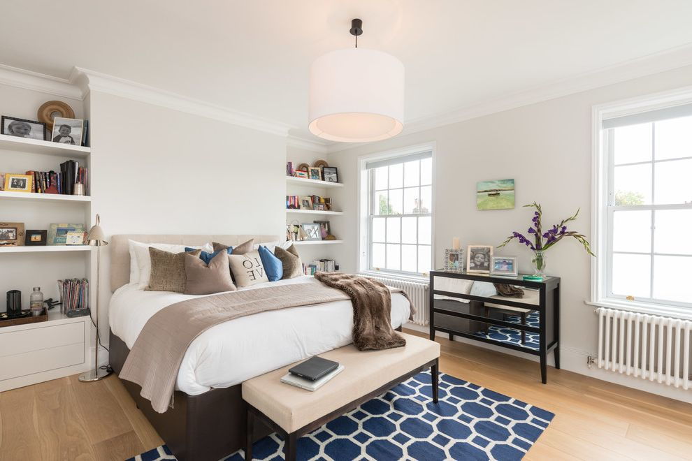 How to Make Your Bedroom Cozy   Transitional Bedroom Also Blue and White Area Rug British Built in Cabinetry Console Table Cosy Cream Cushions Floor Lamp Linen Oak Oak Floor Open Shelving Throw