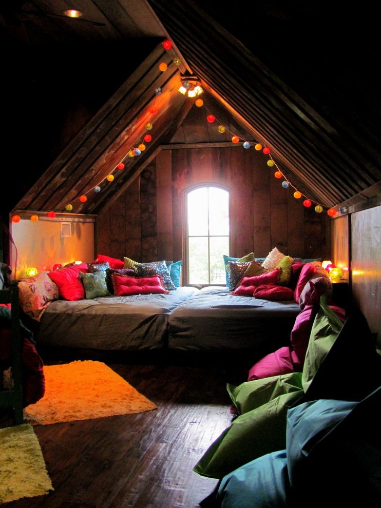 How to Make Your Bedroom Cozy with Eclectic Bedroom  and Alcove Arch Window Area Rug Attic Bedding Bohemian Colorful Pillows Nook Secluded Sloped Ceiling Teen Wood Floor Wood Paneling