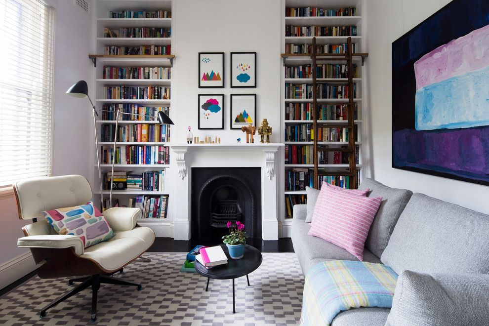How to Make Your Bedroom Cozy with Eclectic Living Room  and Area Rug Blinds Built in Bookshelves Fireplace Graphic Art Gray Sofa Large Colorful Art Library Ladder Lounge Chair Mantel Pink Pillows Small Coffee Table Toys White Leather