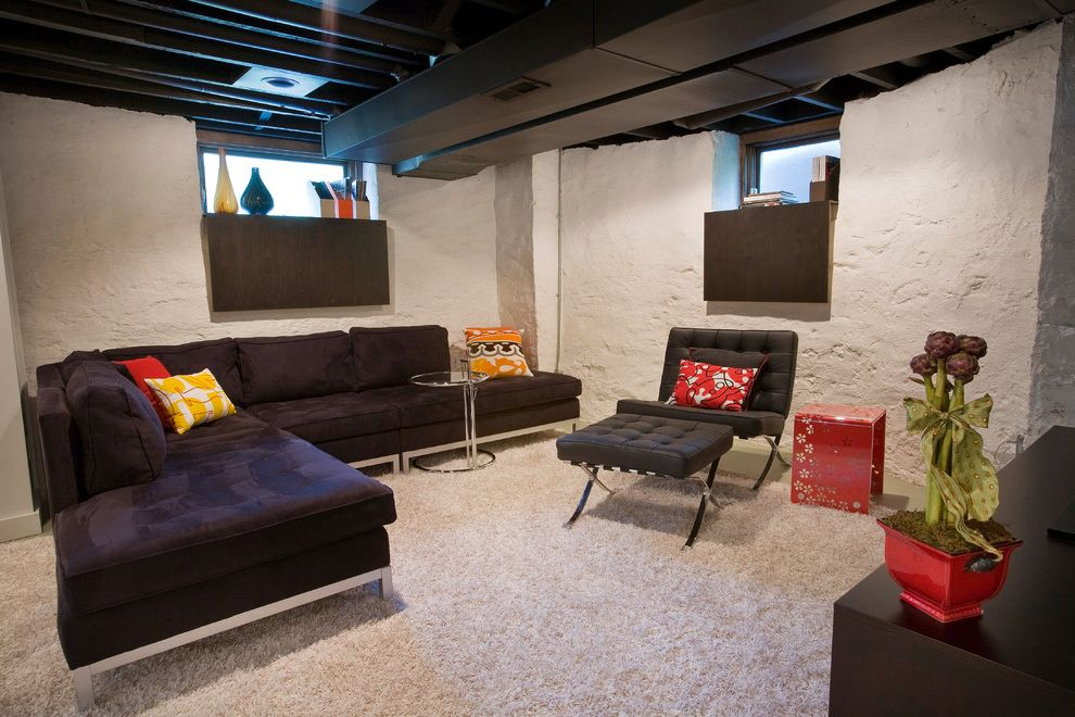 How to Paint Basement Ceiling with Modern Basement Also Area Rug Bar Basement Renovation Black Leather Upholstery Exposed Ducting Exposed Floor Joists Media Room Painted Concrete Walls Red Rough Textured Walls Seating Area Sectional Yellow
