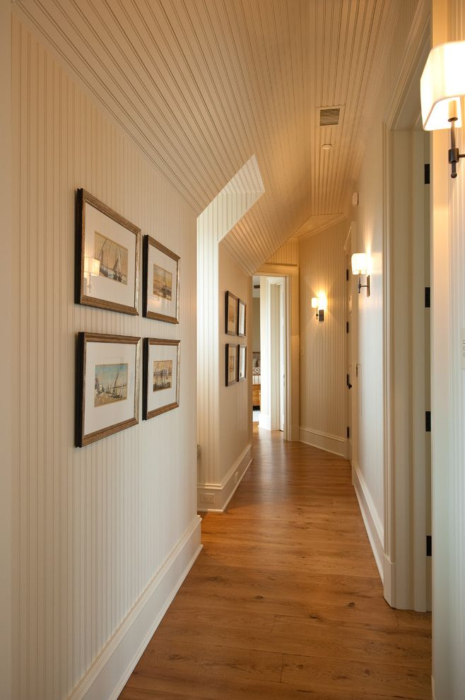 How to Paint Over Wallpaper with Traditional Hall Also Baseboards Beadboard Gallery Wall Sconce Sloped Ceiling Wall Lighting White Wood Wood Ceiling Wood Flooring Wood Trim