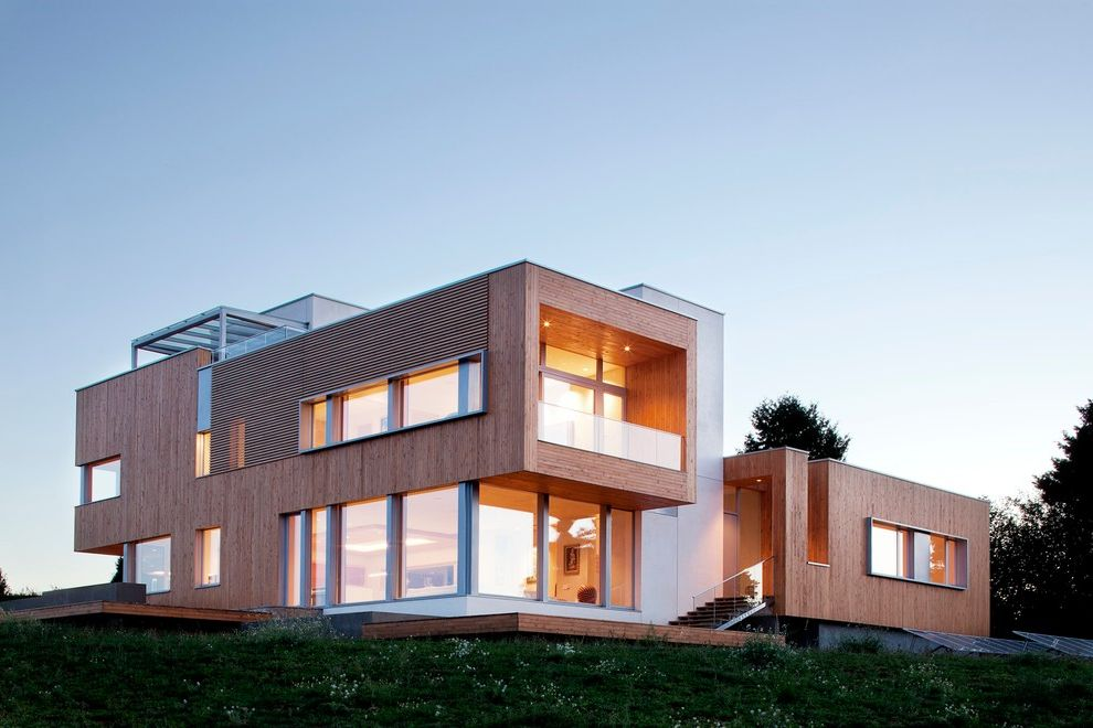 How to Reduce Dust in My House with Contemporary Exterior  and Balcony Cantilever Clean Lines Contemporary Design Flat Roof Glass Guardrail Horizontal Lines Modern Design Modern Home Modern House Passive House Strong Lines Wood Cladding Wood Siding