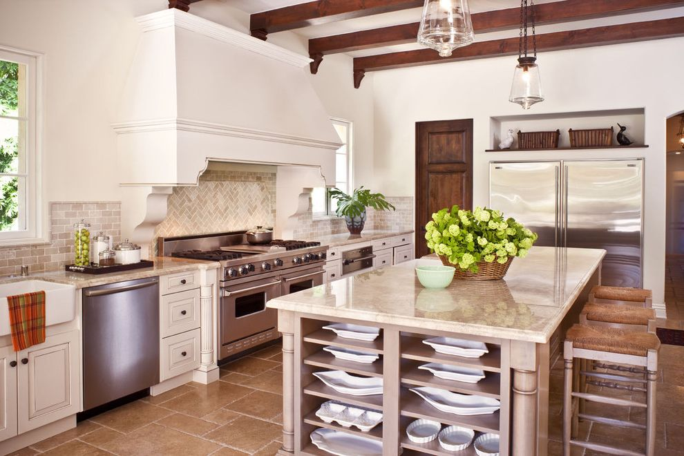 How to Remove Hard Water Stains From Granite   Mediterranean Kitchen  and Country Style Exposed Beams Glass Pendant Lights Herringbone Pattern Island Large Island Relaxed Kitchen Travertine Floors Viking Range Wicker Seat Barstool