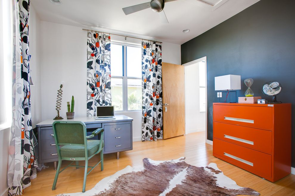 How to Spray Paint Metal Furniture with Eclectic Home Office and Animal Hide Ceiling Fan Cow Floral Curtain Panels Green Desk Chair Metal Metal Desk Orange Filing Cabinet Vintage Window Treatment Wood Door Wood Floor