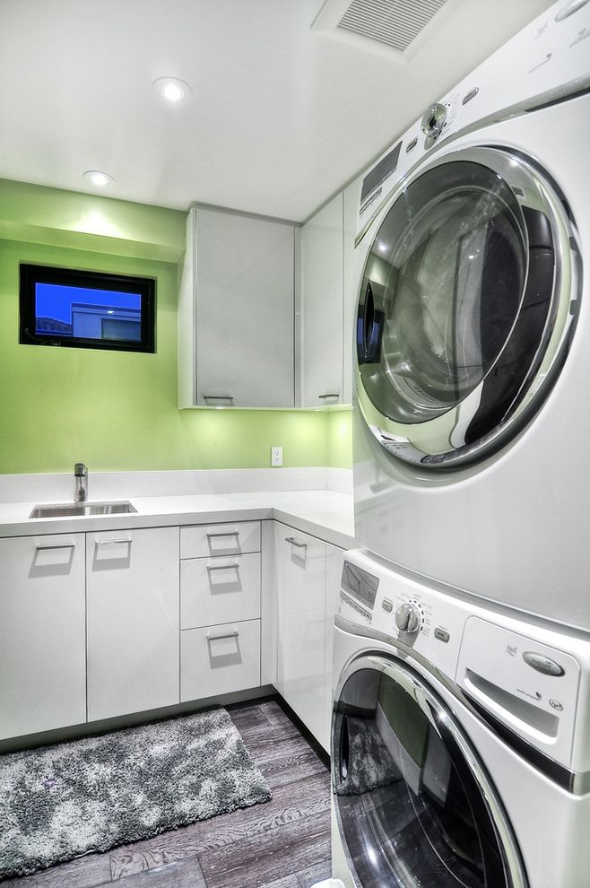 How to Stack a Washer and Dryer   Contemporary Laundry Room Also Bar Pulls Clerestory Window Gray Floor Gray Rug Green Walls Recessed Lighting Sink Stackable Washer and Dryer Stacked Washer and Dryer Stacked Washer Dryer White Cabinets