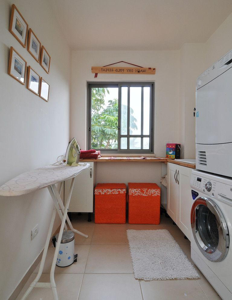 How to Stack a Washer and Dryer   Contemporary Laundry Room  and Frame and Panel Cabinets Hampers Metal Window Orange Sliding Glass Window Stackable Washer and Dryer Stacked Washer and Dryer Stacking Washer Dryer Bath Mat Step Can Tile Floor White Walls