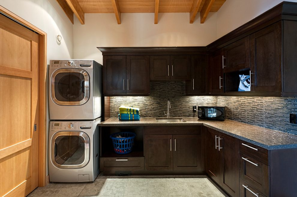 How to Stack a Washer and Dryer with Contemporary Laundry Room Also Built Ins Custom Cabinets Dark Wood Cabinets Dryer Laundry Shaker Cabinets Stackable Washer and Dryer Stacked Washer and Dryer Stainless Steel Undercabinet Lighting Washer