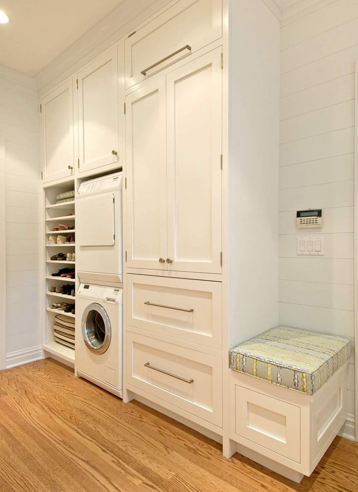 How to Stack a Washer and Dryer with Traditional Laundry Room  and Bench Seat Custom Cabinets Frame and Panel Cabinets Open Shelving Stackable Washer and Dryer Stacked Washer and Dryer Stacking Washer Dryer White Painted Wood Wood Floor Wood Walls