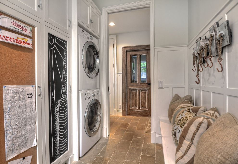 How to Stack a Washer and Dryer with Traditional Laundry Room  and Built in Bench Stackable Washer and Dryer Stacked Washer and Dryer Stacked Washer Dryer Stone Floor Tile Wainscoting