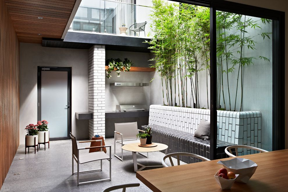 How to Take Care of Bamboo with Contemporary Patio  and Atrium Contemporary Furniture Contemporary Outdoor Furniture Courtyard Garden Design Indoor Outdoor Landscape Design Natural Light Outdoor Furniture Tiled Bench
