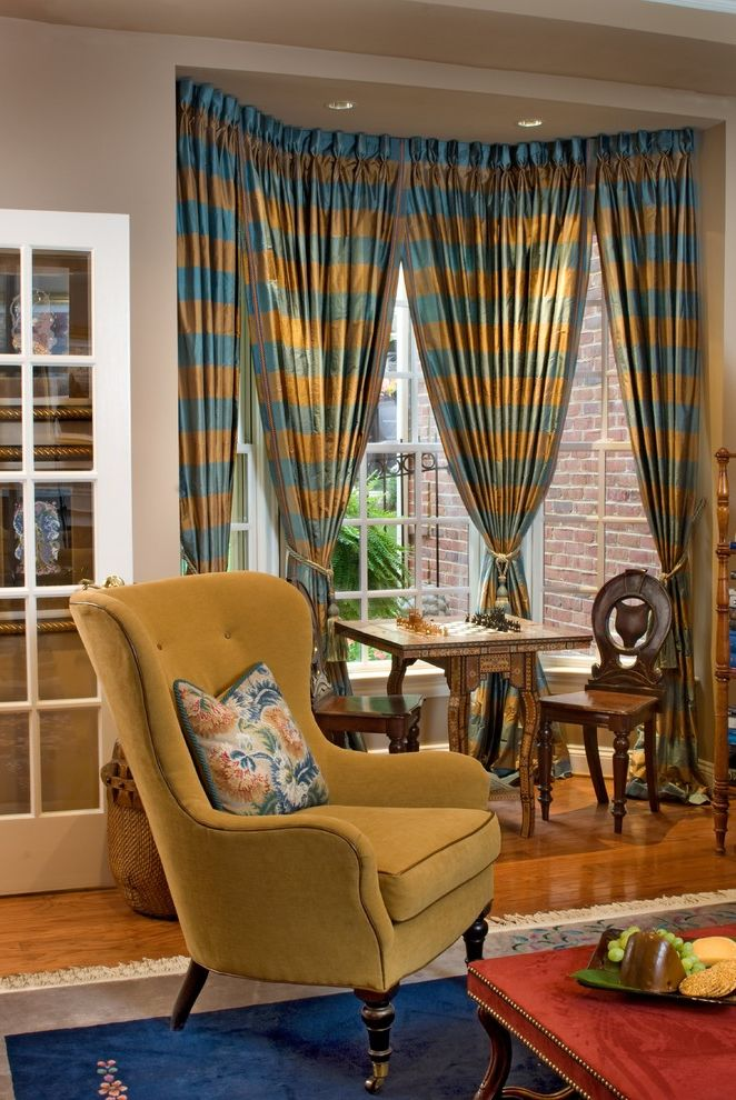 How to Tie Curtains with Traditional Family Room Also Area Rug Bay Window Chessboard Curtains Drapes Nook Stripes Suede Chair Window Treatments Wingback Chair Wood Flooring Yellow Chair