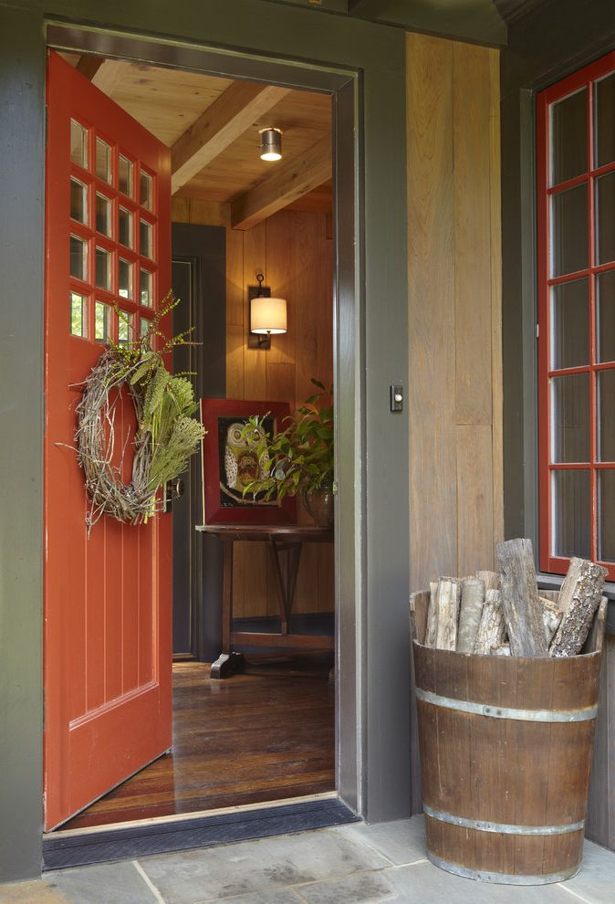 How to Unlock a Door Without a Key   Rustic Entry Also Accent Color Color Dark Trim Divided Light Door Entrance Entry Wreath Entryway Firewood Storage Front Porch Front Stoop Pop of Color Red Door Red Front Door Rustic Wood Door