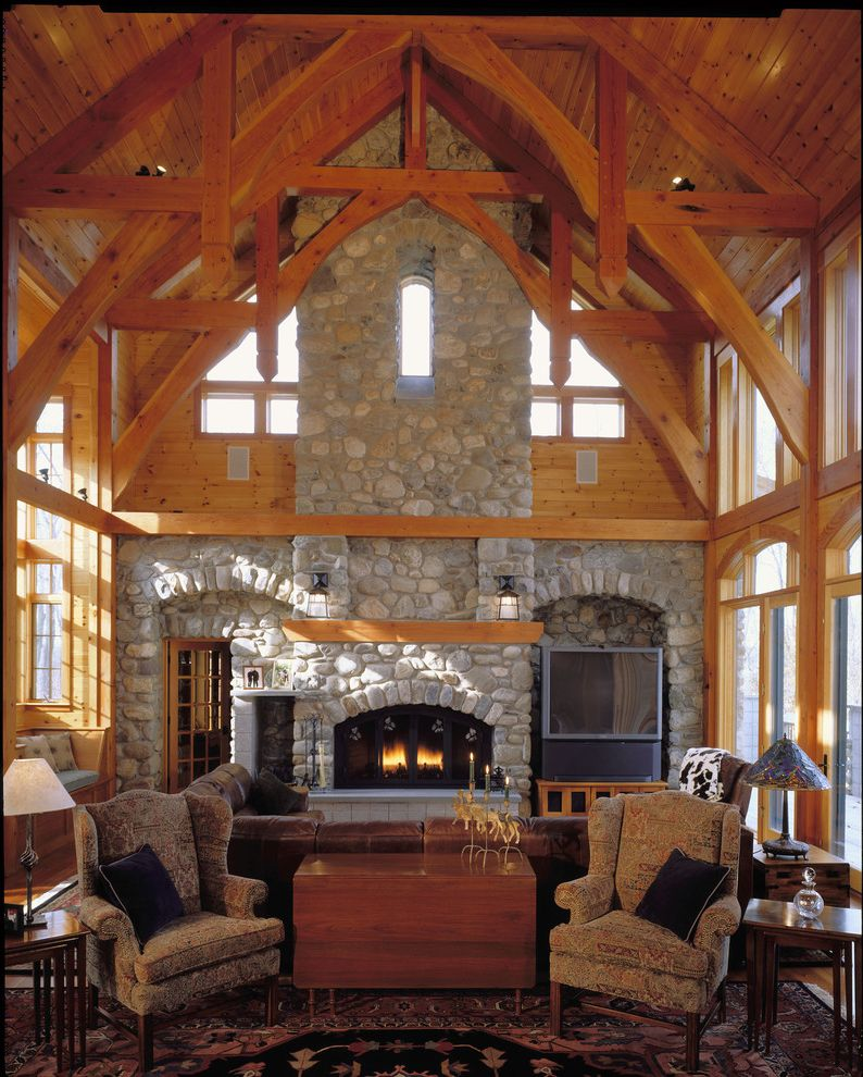 Hunt Country Furniture   Eclectic Family Room  and Arch Transom Chimney Window Clerestory Oriental Rug Raised Hearth Stone Fireplace Stone Wall Timber Frame Timber Mantel Tv Niche Upholstered Chair Window Seat Wing Chair Wood Chest Wood Plank Ceiling