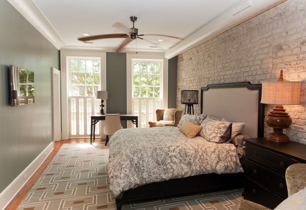 Hvac Charleston Wv with Traditional Bedroom  and Ceiling Fan Exposed Brick Wall Exposed Hvac Plantation Shutters Tall Windows White Trim Whitewashed Brick