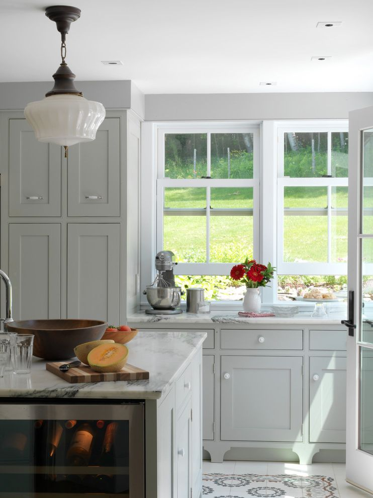 Hy C Company with Farmhouse Kitchen  and Beverage Cooler Double Hung Windows Gray Painted Cabinets Marble Counters Marble Island Pendant Light Tile Floor Vermont Marble Vintage Lighting White Casing White Trim