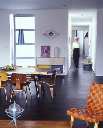 Icon at Dulles   Modern Dining Room  and Concrete Floor Dining Table Eames Chair Eye Clock Frgglatt Love This Matplats Nelson Bench Nelson Clock Picture Plywood Chair Rectangular Table Risom Chair Shelves Side Chair Table Vase Window Wood Table