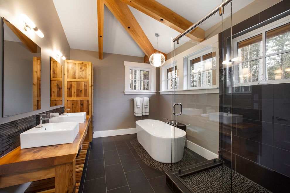 Icon at Dulles   Transitional Bathroom  and Baseboards Double Sinks Double Vanity Exposed Beams Freestanding Bathtub Glass Shower Enclosure Gray Walls Live Edge Wood Countertop Pebble Tile River Rock Vessel Sinks White Trim Wood Countertop
