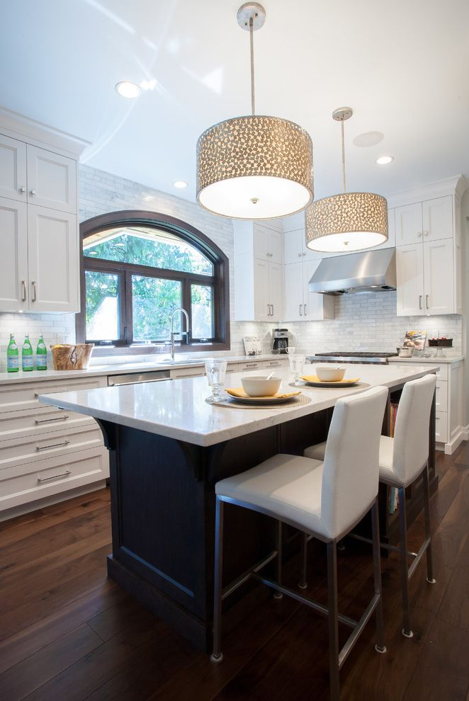 Icon at Dulles with Transitional Kitchen Also Arched Window Bar Stools Custom Millwork Drum Pendant Light Hardwood Island Recessed Lighting White Bar Stools White Cabinets White Countertop