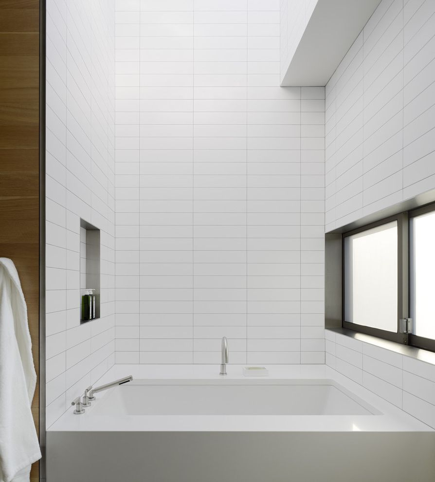 Ideal Tile Newton with Modern Bathroom  and Bathroom Window Minimal Modern Bath Fixtures Monochromatic Niche Shower Shelf Sliding Window Soaking Tub Tile Wall White Bathroom