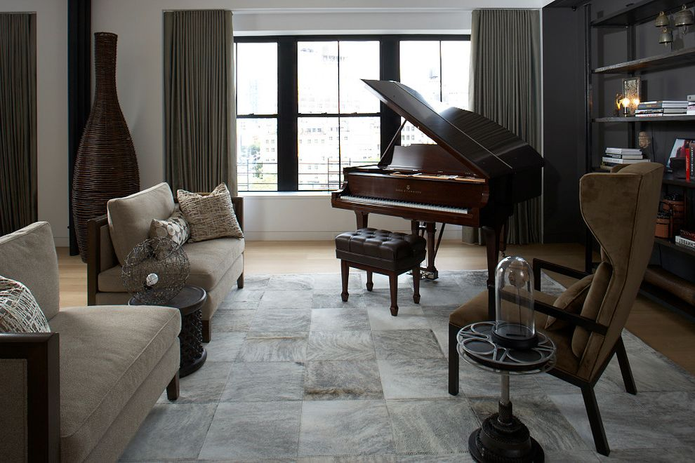 Ikea Cowhide Rug with Industrial Family Room  and Bookshelves Cowhide Rug Dark Wood Grand Piano Eclectic Gray Rug Industrial Interieurs Library Limited Editions Living Room Loft New York City Xander Sofa