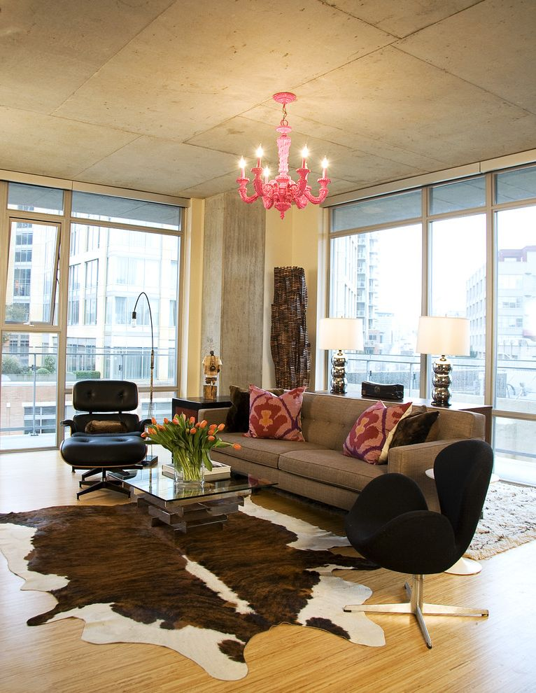 Ikea Cowhide Rug with Industrial Living Room Also Area Rug Concrete Cowhide Rug Decorative Pillows Floral Arrangement Glass Wall Industrial Loft Mirrored Coffee Table Modern Icons Pink Chandelier Throw Pillows