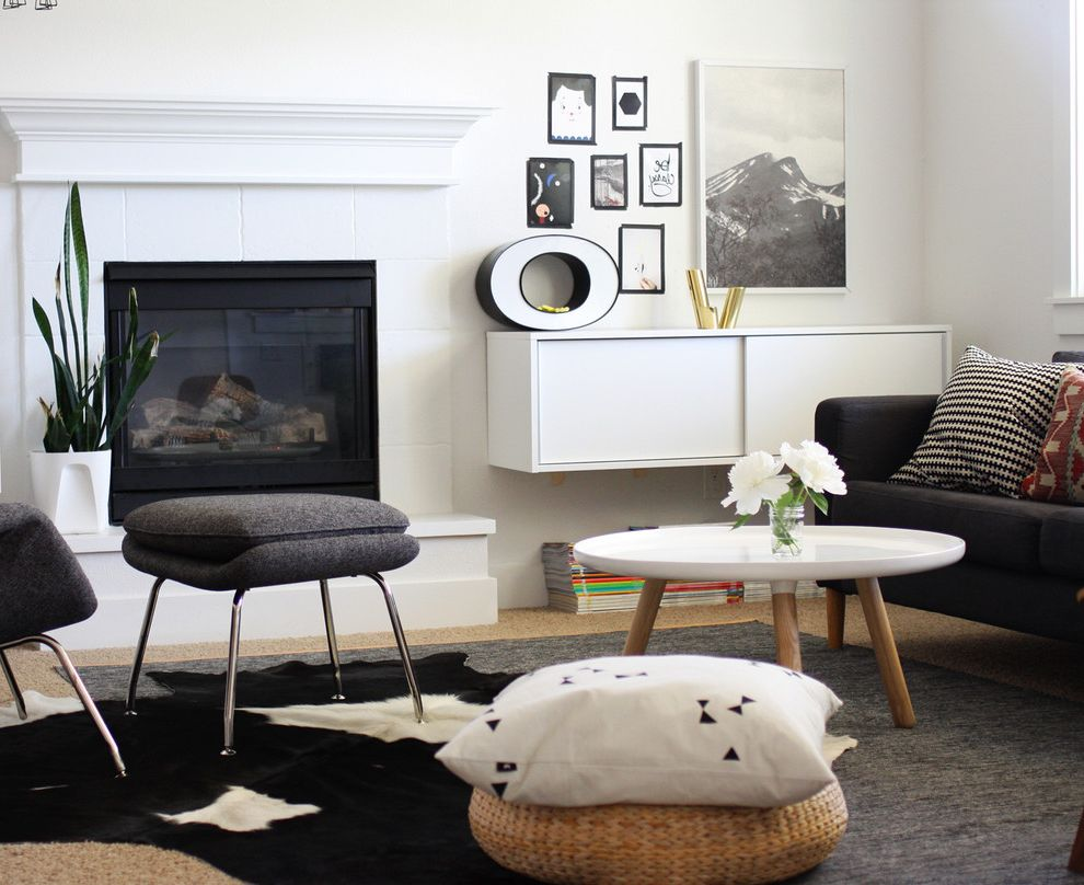 Ikea Cowhide Rug with Scandinavian Living Room Also Cowhide Rug Fireplace Floating Sideboard Floral Arrangement Gallery Wall Neutral Colors Stacked Magazines White Coffee Table Woven Pouf